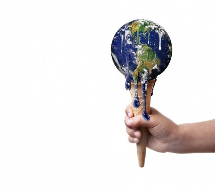 Mundo como helado derritiéndose. Calentamiento global