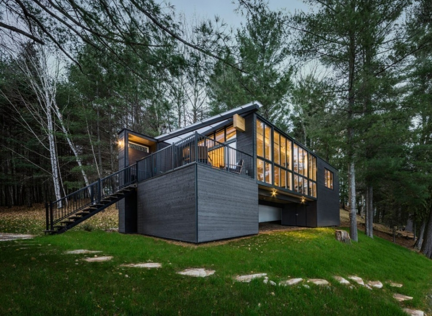 Casa de paneles de madera-