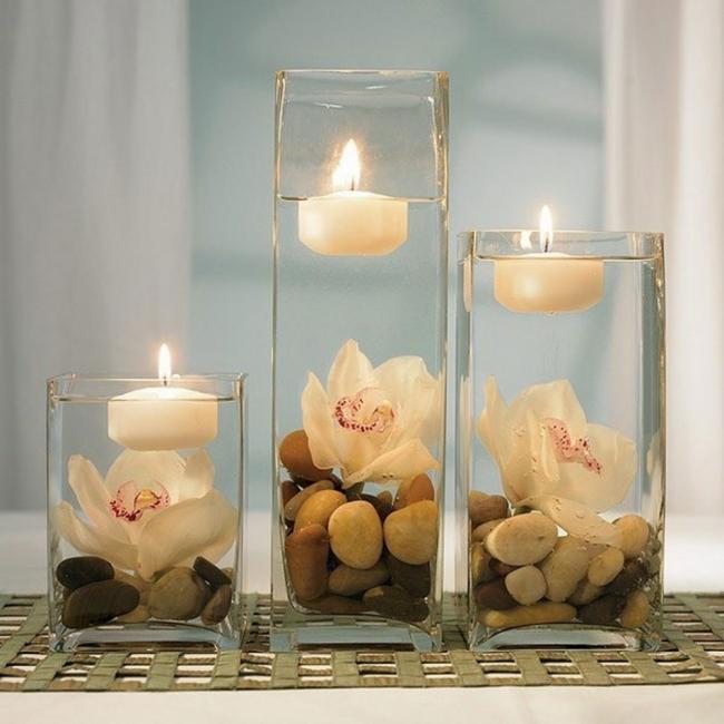 Ideas para decorar tus velas navideñas - velas flotantes con piedras