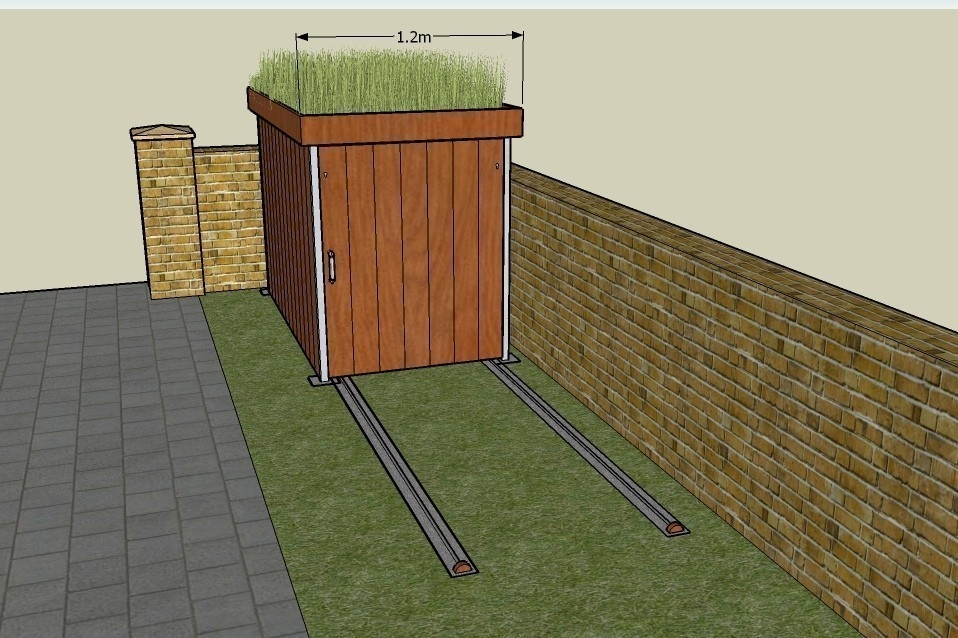 garaje para bicicletas con techo verde- rieles