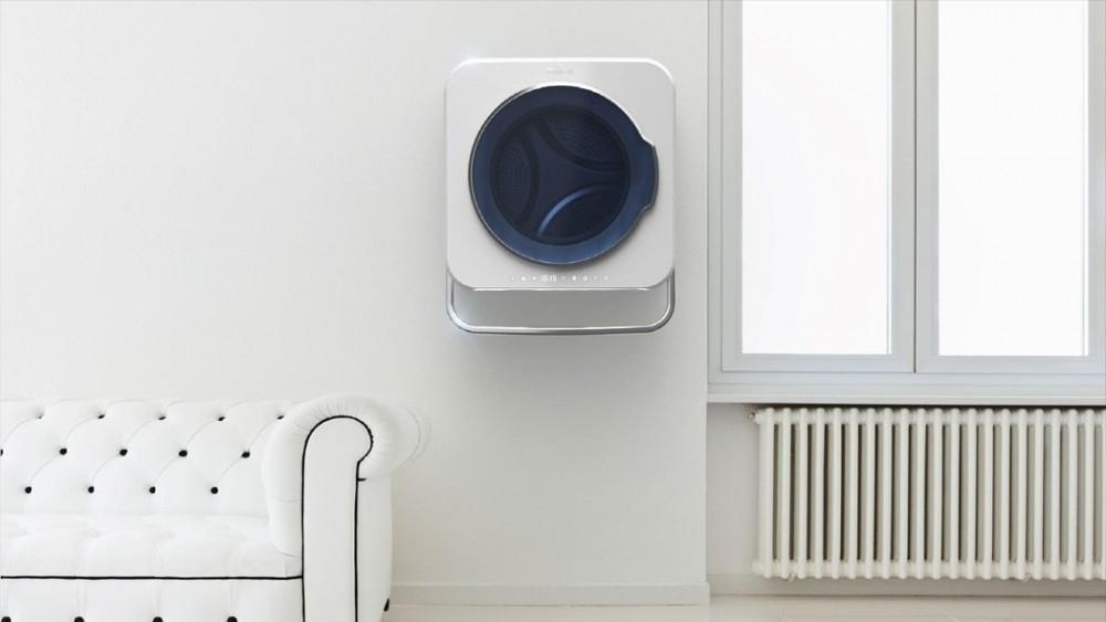 Una ingeniosa lavadora de pared que ahorra espacio y energía