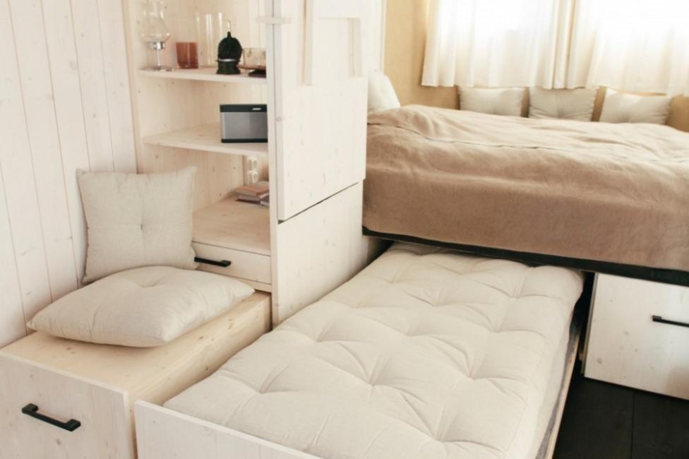 Una encantadora casita en muy pocos metros cuadrados- cama