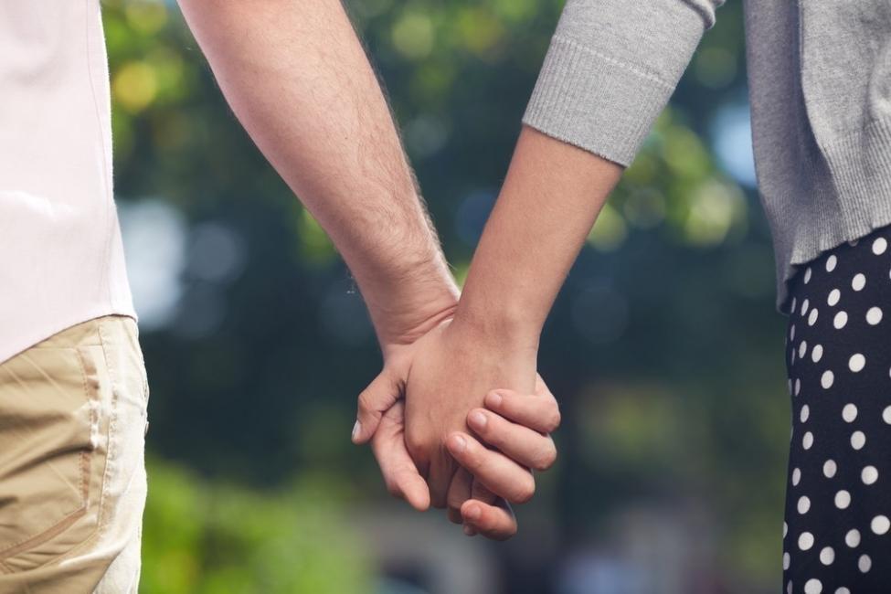 pareja palmas manos