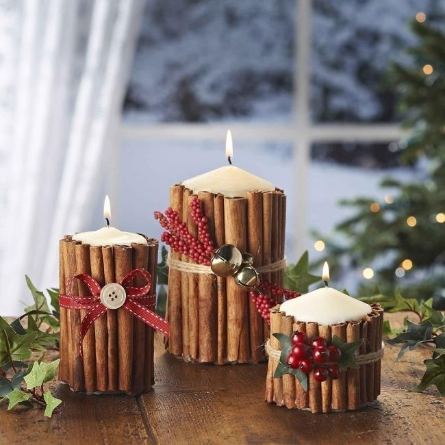 Ideas para decorar tus velas navideñas - velas con ramas de canela